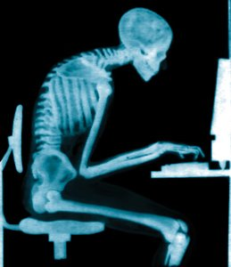 skeleton at desk